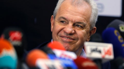 Egypt's new national football team coach Javier Aguirre, smiles during a press conference in Cairo, Egypt, Thursday, Aug. 2, 2018. Aguirre, a Mexican, will be paid $1.4 million a year and will receive a $500,000 bonus if Egypt qualifies for the World Cup in 2022 in Qatar, Abo Rida said. (AP Photo/Amr Nabil)