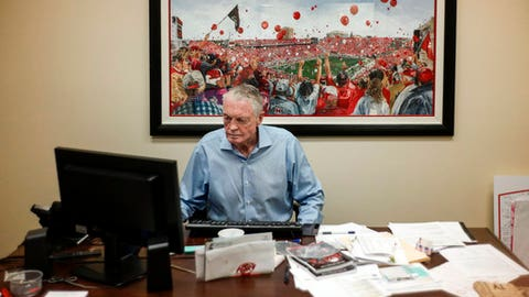 In this July 31, 2018, photo, former Nebraska coach Tom Osborne works in his office in Lincoln, Neb. Current Nebraska NCAA college football head coach Scott Frost has said repeatedly that Nebraska made a mistake moving away from the methods Osborne successfully used. Frost's job is to return his team to the place it held in the college football hierarchy two decades ago by returning to the methods Osborne used on and off the field to make the Cornhuskers great. (AP Photo/Nati Harnik)