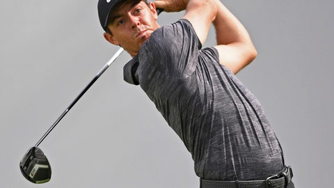 Rory McIlroy, from Northern Ireland, follows his tee shot on the 10th hole during the first round of the Bridgestone Invitational golf tournament at Firestone Country Club, Thursday, Aug. 2, 2018, in Akron, Ohio. (AP Photo/David Dermer)