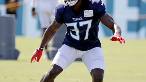 FILE - In this July 29, 2018, file photo, Tennessee Titans defensive back Johnathan Cyprien runs a drill during NFL football training camp in Nashville, Tenn. Cyprien will miss the season with a torn left ACL, and coach Mike Vrabel says veteran Eric Reid is among the safeties the Titans want to look at for a potential replacement. Cyprien left practice Wednesday, Aug. 1, 2018, after grabbing at his left knee. (AP Photo/Mark Humphrey, File)