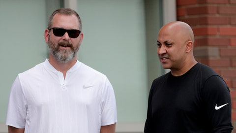 Kevin Abrams, left, New York Giants assistant general manager, stands with Zeke Sandhu, sports agent who represents wide receiver Odell Beckham, during NFL football training camp, Thursday, Aug. 2, 2018, in East Rutherford, N.J. (AP Photo/Julio Cortez)