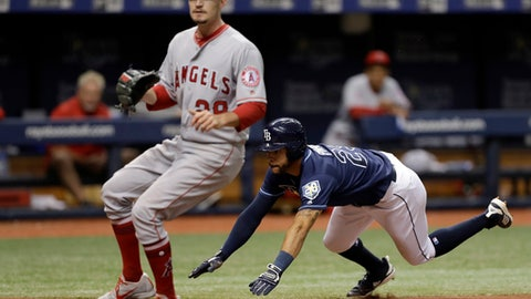 Tampa Bay Rays' Tommy Pham, right, scores on a wild pitch from Los Angeles Angels starting pitcher Andrew Heaney, left, during the fourth inning of a baseball game Thursday, Aug. 2, 2018, in St. Petersburg, Fla. (AP Photo/Chris O'Meara)