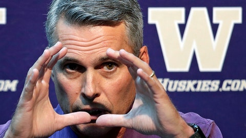 Washington head football coach Chris Petersen motions as he speaks at a news conference Thursday, Aug. 2, 2018, in Seattle. Petersen hates expectations, so he's likely loathing Washington being the overwhelming favorite in the Pac-12 and likely top 10 when the preseason AP poll comes out. The Huskies open fall camp on Friday in preparation for the Sept. 1 opener against Auburn. (AP Photo/Elaine Thompson)