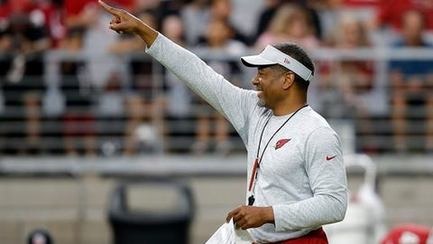 Arizona Cardinals coach Steve Wilks smiles as he points to a coach during NFL football training camp Thursday, Aug. 2, 2018, in Glendale, Ariz. (AP Photo/Ross D. Franklin)