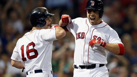 Boston Red Sox's Steve Pearce celebrates his home run that scored Andrew Benintendi (16) and another player during the fourth inning of a baseball game against the New York Yankees in Boston, Thursday, Aug. 2, 2018. (AP Photo/Michael Dwyer)