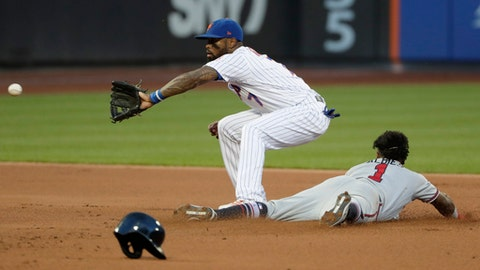 Atlanta Braves' Ozzie Albies (1) slides past New York Mets shortstop Jose Reyes (7) to steal second base during the first inning of a baseball game Thursday, Aug. 2, 2018, in New York. The Braves won 4-2. (AP Photo/Frank Franklin II)