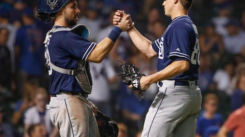 San Diego Padres' Phil Maton, right, celebrates with Austin Hedges, left, after the Padres defeated the Chicago Cubs 6-1 in a baseball game Thursday, Aug. 2, 2018, in Chicago. (AP Photo/Kamil Krzaczynski)