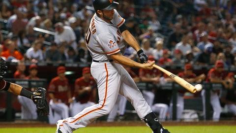 San Francisco Giants' Madison Bumgarner hits an RBI single during the fifth inning against the Arizona Diamondbacks in a baseball game Thursday, Aug. 2, 2018, in Phoenix. (AP Photo/Rick Scuteri)