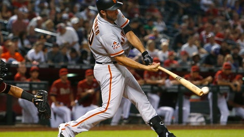 San Francisco Giants' Madison Bumgarner hits an RBI single during the fifth inning against the Arizona Diamondbacks in a baseball game Thursday, Aug. 2, 2018, in Phoenix. (AP Photo/Rick Scuteri)