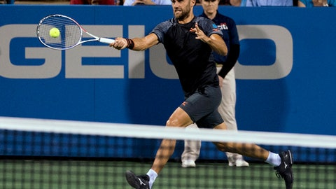 Marius Copil, of Romania, hits a forehand to Andy Murray, of Britain, during the Citi Open tennis tournament in Washington, early Friday, Aug. 3, 2018. (AP Photo/Andrew Harnik)