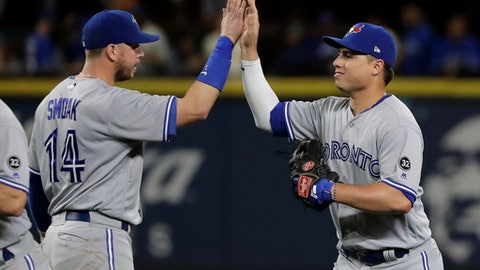 Toronto Blue Jays' Aledmys Diaz, right, greets Justin Smoak after the team's baseball game against the Seattle Mariners, Thursday, Aug. 2, 2018, in Seattle. The Blue Jays won 7-3. (AP Photo/Ted S. Warren)