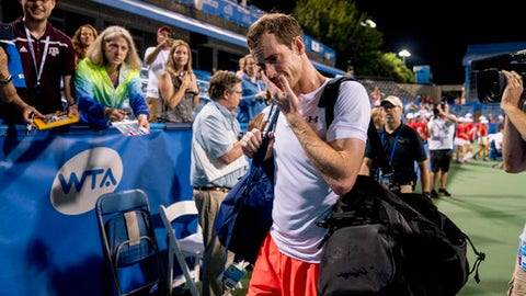 An emotional Andy Murray, of Britain, steps off court after defeating Marius Copil, of Romania, 6-7 (5), 3-6, 7-6 (4), during the Citi Open tennis tournament in Washington, Friday, Aug. 3, 2018. (AP Photo/Andrew Harnik)
