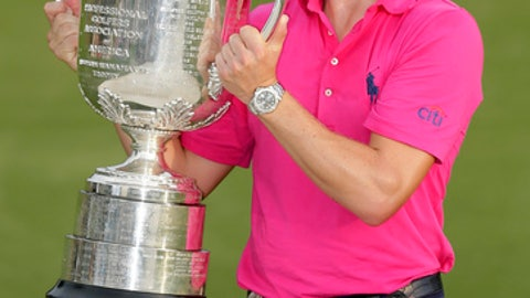 FILE - In this Aug. 13, 2017, file photo, Justin Thomas poses with the Wanamaker Trophy after winning the PGA Championship golf tournament at the Quail Hollow Club in Charlotte, N.C. Thomas will try to join Tiger Woods as the only back-to-back winners of the PGA in stroke play. (AP Photo/Chuck Burton, File)