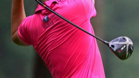 Ian Poulter, from England, watches his tee shot on the second hole during the second round of the Bridgestone Invitational golf tournament at Firestone Country Club, Friday, Aug. 3, 2018, in Akron, Ohio. (AP Photo/David Dermer)