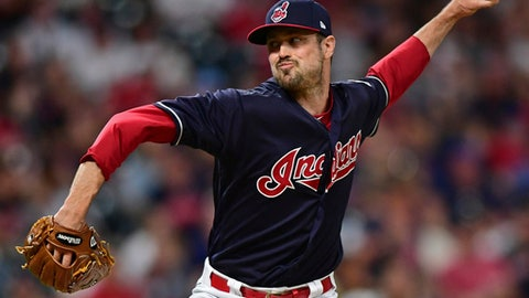 FILE - In this May 25, 2018, file photo, Cleveland Indians relief pitcher Andrew Miller delivers during the seventh inning of the team's baseball game against the Houston Astros in Cleveland. Andrew Miller has been activated by the Cleveland Indians after missing two months because of inflammation in his right knee. Miller, who was on the 60-day disabled list, has been out since May 26. The left-hander also missed time this season with a strained left hamstring.(AP Photo/David Dermer, File)