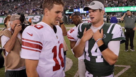 <p>               New York Giants quarterback Eli Manning (10) and New York Jets quarterback Sam Darnold (14) meet at midfield after a preseason NFL football game, Friday, Aug. 24, 2018, in East Rutherford, N.J. (AP Photo/Julio Cortez)             </p>