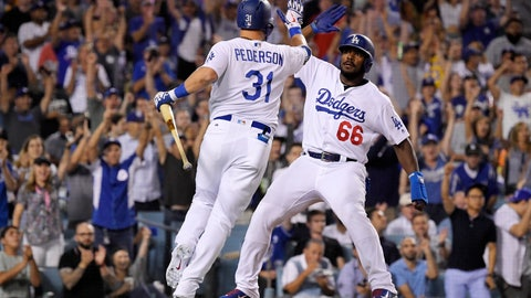 <p>               Los Angeles Dodgers' Yasiel Puig, right, celebrates with Joc Pederson afters scoring on a sacrifice by Pederson during the sixth inning against the San Francisco Giants in a baseball game Wednesday, Aug. 15, 2018, in Los Angeles. (AP Photo/Mark J. Terrill)             </p>