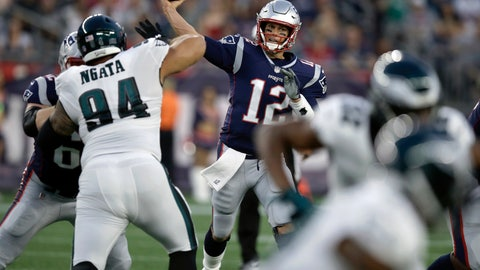 <p>               New England Patriots quarterback Tom Brady (12) throws a pass under pressure from Philadelphia Eagles defensive tackle Haloti Ngata (94) during the first half of a preseason NFL football game Thursday, Aug. 16, 2018, in Foxborough, Mass. (AP Photo/Charles Krupa)             </p>