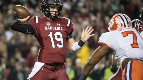 <p>               FILE - In this Saturday, Nov. 25, 2017, file photo, South Carolina quarterback Jake Bentley (19) attempts a pass against Clemson defensive end Austin Bryant (7) during the first half of an NCAA college football game, in Columbia, S.C. South Carolina has pinned much of its hopes for an improved offense on a fast-paced, quick strike attack it's worked on since changing offensive coordinators last December.  The first try for the Gamecocks comes Saturday when they open the season at home against Coastal Carolina of the Sun Belt Conference.(AP Photo/Sean Rayford, File)             </p>