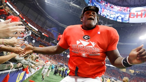 <p>               FILE - In this Dec. 2, 2017, file photo, Georgia offensive lineman Isaiah Wilson celebrates a Georgia win over Auburn in the Southeastern Conference championship NCAA college football game in Atlanta. Wilson has been working with Georgia's first-team offense at right tackle for much of preseason camp as the Bulldogs attempt to replace New England Patriots first-round draft pick Isaiah Wynn, who was the starting left tackle last season. (AP Photo/David Goldman, File)             </p>