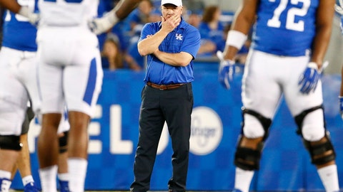 <p>               Kentucky head coach Mark Stoop watches his team during the NCAA college football Blue-White Spring Game Friday April 13, 2018 at Kroger Field in Lexington, Ky., Friday, April 13, 2018.  (Silas Walker/Lexington Herald-Leader via AP)             </p>