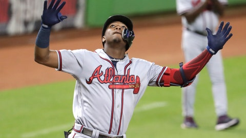 <p>               Atlanta Braves' Ronald Acuna Jr. reacts after hitting a solo home run during the third inning of the team's baseball game against the Miami Marlins, Thursday, Aug. 23, 2018, in Miami. (AP Photo/Lynne Sladky)             </p>