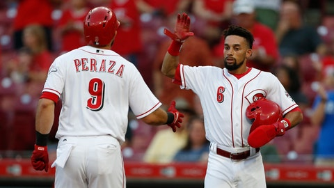 <p>               Cincinnati Reds' Jose Peraza (9) is congratulated on a two-run home run off Milwaukee Brewers starting pitcher Junior Guerra by Billy Hamilton (6) during the first inning of a baseball game, Tuesday, Aug. 28, 2018, in Cincinnati. (AP Photo/Gary Landers)             </p>