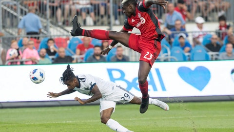 <p>               Vancouver Whitecaps forward Yordi Reyna, left, dives to get a header in front of Toronto FC defender Chris Mavinga during the first half in the second leg of the Canadian soccer championship final, Wednesday, Aug. 15, 2018, in Toronto. (Chris Young/The Canadian Press via AP)             </p>