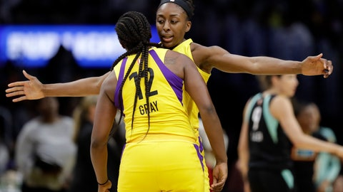 <p>               Los Angeles Sparks' Nneka Ogwumike, center right, celebrates after scoring with teammate Chelsea Gray (12) during the second half of a WNBA basketball game against the New York Liberty, Tuesday, Aug. 14, 2018, in Los Angeles. (AP Photo/Marcio Jose Sanchez)             </p>