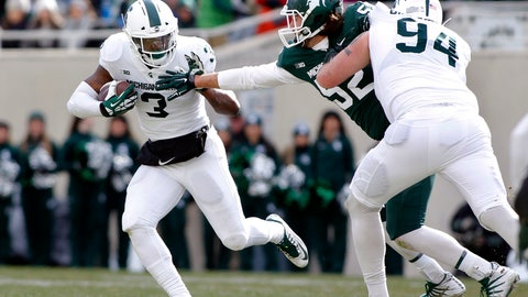 <p>               FILE - In this Saturday, April 7, 2018 file photo, Michigan State running back LJ Scott, left, rushes against defensive end Dillon Alexander as offensive lineman Chase Gianacakos (94) blocks during the first half of a spring NCAA college football scrimmage in East Lansing, Mich. The NFL can wait for now. LJ Scott is back at Michigan State with a list of areas he'd like to shore up. Scott's return after his junior season was big news for the Spartans, who now look like Big Ten title contenders in 2018. (AP Photo/Al Goldis)             </p>