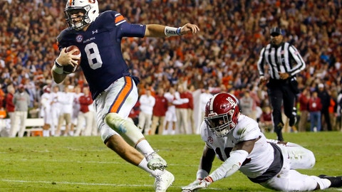 <p>               FILE-In this Nov. 25, 2017, file photo, Auburn quarterback Jarrett Stidham (8) gets past Alabama linebacker Dylan Moses (18) to carry the ball in for a touchdown during the second half of the Iron Bowl NCAA college football game, in Auburn, Ala. Auburn has high hopes for Stidham, who was one of the SEC's most efficient passers as a first-year starter. Auburn hasn't had a two-year starter at quarterback since Nick Marshall in 2013 and 2014.  (AP Photo/Butch Dill, File)             </p>