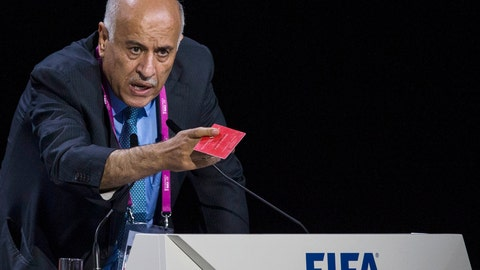 <p>               FILE - In this Friday, May 29, 2015 file photo Jibril Rajoub, president of the Palestinian Football Association speaks during the 65th FIFA Congress held at the Hallenstadion in Zurich, Switzerland. FIFA has banned the head of the Palestinian Football Association from attending soccer games for a year for inciting hatred and violence toward Lionel Messi. Jibril Rajoub called on Arab soccer fans to burn Messi posters and shirts if he participated in an Argentina game in Israel in June. (Patrick B. Kraemer/Keystone via AP, File)             </p>