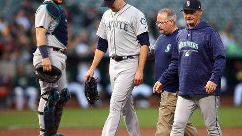 <p>               Seattle Mariners pitcher James Paxton, second from left, is escorted off the field after being hit by a ball in the first inning of a baseball game against the Oakland Athletics Tuesday, Aug. 14, 2018, in Oakland, Calif. (AP Photo/Ben Margot)             </p>