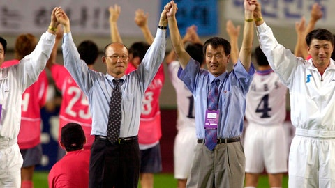 "<p>               FILE - In this Saturday, Sept. 7, 2002 file photo, South Korean national soccer team's head coach Park Hang-seo, second from left, and North Korean head coach Ri Jung-man, second from right, with the two team's players, raise their hands to South Korean soccer fans after their friendly match for unification of both Koreas, at the Sangam World Cup Stadium in Seoul, South Korea. If South Korea's national team is to reach the final of the Asian Games and win an exemption from military service for its players, then it will have to get past Vietnam and the ""Korean Hiddink."" Korean coach Park Hang-seo, a member of Guus Hiddink's coaching staff at the 2002 World Cup when South Korea reached the semifinals, is coaching Vietnam. (AP Photo/ Yun Jai-hyoung)             </p>"