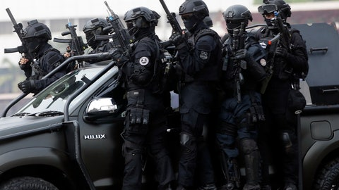 <p>               In this July 25, 2018, photo, members of joint Indonesian police and military special forces take part in an anti-terrorism drill ahead of the 2018 Asian Games in Jakarta, Indonesia. Indonesia is deploying 100,000 police and soldiers to provide security for the Asian Games, the biggest event ever held in its terror attack prone capital Jakarta, parts of which have been dramatically spruced up as the city readies to welcome tens of thousands of athletes and visitors. (AP Photo/Tatan Syuflana)             </p>