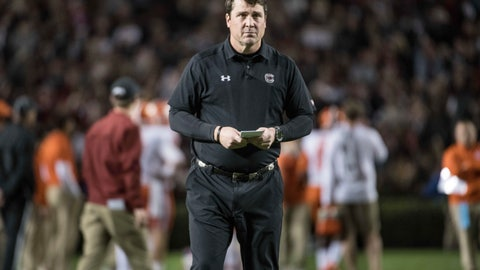 <p>               FILE - In this Nov. 25, 2017 file photo, South Carolina head coach Will Muschamp watches his players before an NCAA college football game against Clemson, in Columbia, S.C. (AP Photo/Sean Rayford, File)             </p>