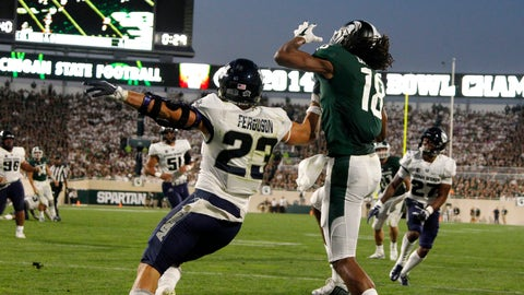 <p>               Michigan State's Felton Davis III (18) catches a pass in the end zone for a touchdown against Utah State's Gaje Ferguson (23) during the second quarter of an NCAA college football game, Friday, Aug. 31, 2018, in East Lansing, Mich. (AP Photo/Al Goldis)             </p>