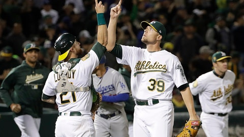 <p>               Oakland Athletics catcher Jonathan Lucroy (21) and pitcher Blake Treinen (39) celebrate after the Athletics defeated the Los Angeles Dodgers 3-2 in a baseball game in Oakland, Calif., Wednesday, Aug. 8, 2018. (AP Photo/Jeff Chiu)             </p>