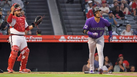 <p>               Colorado Rockies' Carlos Gonzalez, right, runs to first as he hits a two-run home run while Los Angeles Angels catcher Rene Rivera watches during the first inning of a baseball game, Tuesday, Aug. 28, 2018, in Anaheim, Calif. (AP Photo/Mark J. Terrill)             </p>