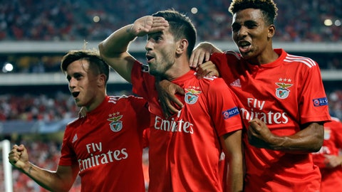 <p>               Benfica's Pizzi, center, celebrates scoring his side's first goal from a penalty kick during the Champions League playoffs, first leg, soccer match between Benfica and PAOK at the Luz stadium in Lisbon, Tuesday, Aug. 21, 2018. (AP Photo/Armando Franca)             </p>