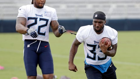 <p>               FILE - In this July 26, 2018, file photo, Tennessee Titans running back Dion Lewis (33) carries a ball tethered to a strap held by running back Derrick Henry (22) during NFL football training camp in Nashville, Tenn. Coach Mike Vrabel best sums up Tennessee's new backfield combination of Henry and Lewis when he says he'd rather not try to tackle Henry or defend against Lewis. (AP Photo/Mark Humphrey)             </p>