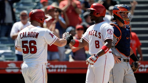 <p>               Los Angeles Angels' Justin Upton, center, is met at the plate by teammate Kole Calhoun (56) after hitting a two-run home run against the Detroit Tigers during the fifth inning of a baseball game Wednesday, Aug. 8, 2018, in Anaheim, Calif. (AP Photo/Marcio Jose Sanchez)             </p>