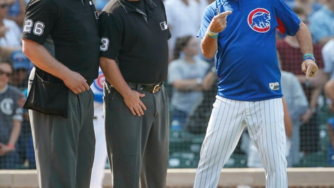 <p>               Chicago Cubs manager Joe Maddon, right, argues a call against his team with umpire's Bill Miller, left, and Todd Tichenor, center, as he is ejected from a baseball game against the Washington Nationals during the seventh inning, Friday, Aug. 10, 2018, in Chicago. (AP Photo/Kamil Krzaczynski)             </p>