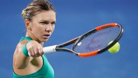 <p>               Simona Halep, of Romania, prepares to serve to Ajla Tomljanovic, of Australia, during the Western & Southern Open tennis tournament Wednesday, Aug. 15, 2018, in Mason, Ohio. (AP Photo/John Minchillo)             </p>