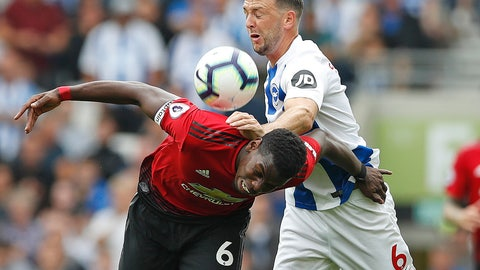 <p>               Manchester United's Paul Pogba, left, and Brighton's Dale Stephens battle for the ball during the English Premier League soccer match between Brighton and Hove Albion and Manchester United at the Amex stadium in Brighton, England, Sunday, Aug.19, 2018. (AP Photo/Alastair Grant)             </p>