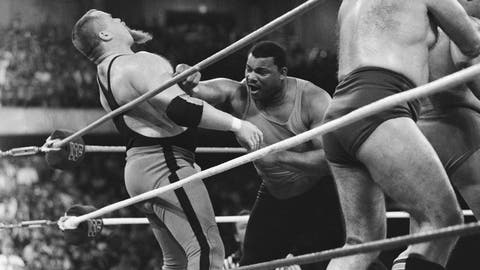 "<p>               File-This April 7, 1986, file photo shows Chicago Bears' William Perry, right, landing a punch on pro wrestler Jim ""The Anvil"" Neidhart during the ""Over-The-Top-Rope"" battle royal at Wrestlemania 2 in Rosemont, Ill. Neidhart, who joined with Bret Hart to form one of the top tag teams in the 1980s with the WWE, has died. He was 63. The Pasco Sheriff's Office said Neidhart fell at home, hit his head and ""succumbed to his injury"" on Monday, Aug. 13, 2018, in Wesley Chapel, Fla. No foul play was suspected. (AP Photo/Charlie Bennett, File)             </p>"