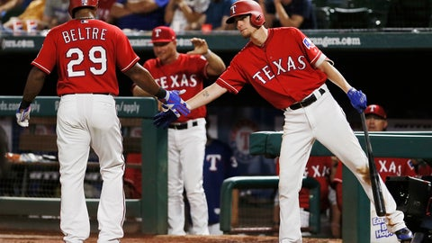 <p>               Texas Rangers' Adrian Beltre (29) is congratulated by Carlos Tocci, right, after scoring on an RBI single hit by Robinson Chirinos, not pictured, during the eighth inning of a baseball game against the Arizona Diamondbacks, Monday, Aug. 13, 2018, in Arlington, Texas. Texas won 5-3. (AP Photo/Brandon Wade)             </p>