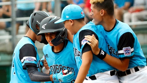 <p>               Puerto Rico's Eric Rodriguez, second from left, is greeted at home plate by his teammates Luis A. Rivera, left, Yadiel Delgado and Carlos De Jesus after his home run against Australia in the fourth inning of an elimination baseball game in International pool play at the Little League World Series tournament in South Williamsport, Pa., Saturday, Aug. 18, 2018. (AP Photo/Tom E. Puskar)             </p>
