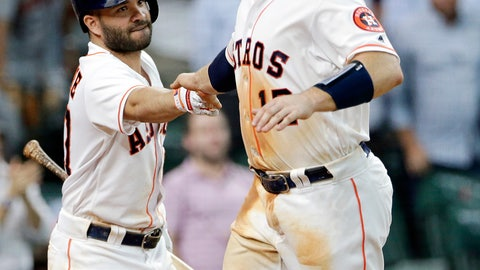 <p>               Houston Astros' Jose Altuve, left, congratulates Max Stassi (12) after he scores the go ahead run on the single by George Springer, making the score 4-3 during the fourth inning of a baseball game against the Oakland Athletics Wednesday, Aug. 29, 2018, in Houston. (AP Photo/Michael Wyke)             </p>