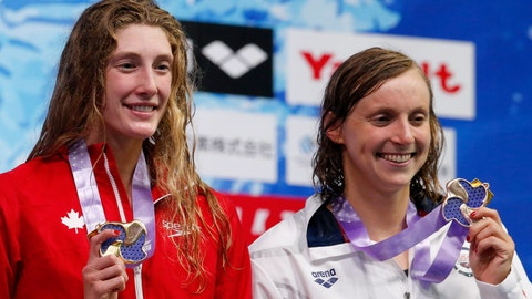 <p>               Canada's Taylor Ruck, left, reacts on the podium after winning the women's 200m freestyle final with third placed Katie Ledecky of the US at the Pan Pacific swimming championships in Tokyo, Japan, Thursday, Aug. 9, 2018. (AP Photo/Shuji Kajiyama)             </p>